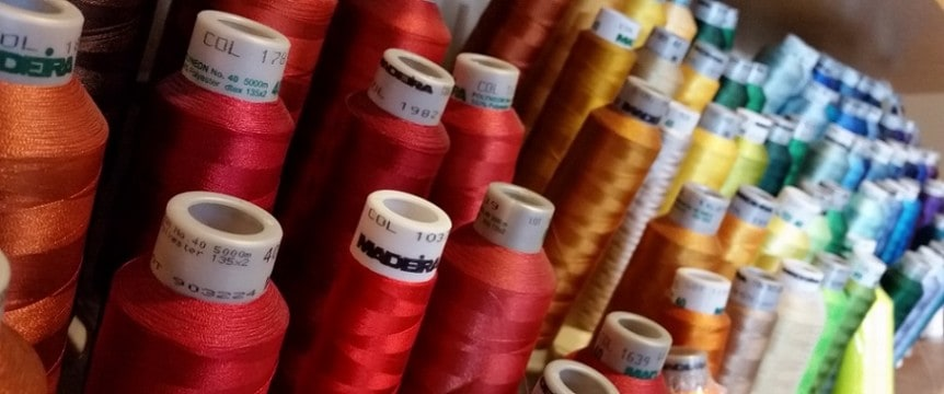 photo of embroidery thread cones in color array - Portland Seattle