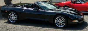 Cropped photo of black Corvette roadster