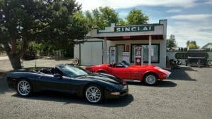 Photo of corvette roadsters at gas station