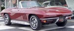 Cropped photo fo vintage burgundy Corvette convertible