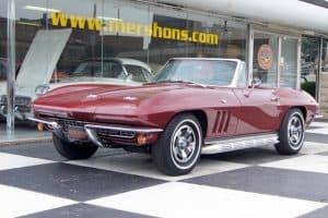 Photo of burgundy vintage Corvette at dealer