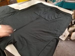 Images of hoodie resting on screen printing plate