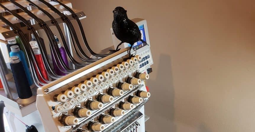 image of fake crow on an embroidery machine - Portland, Bellevue, San Jose
